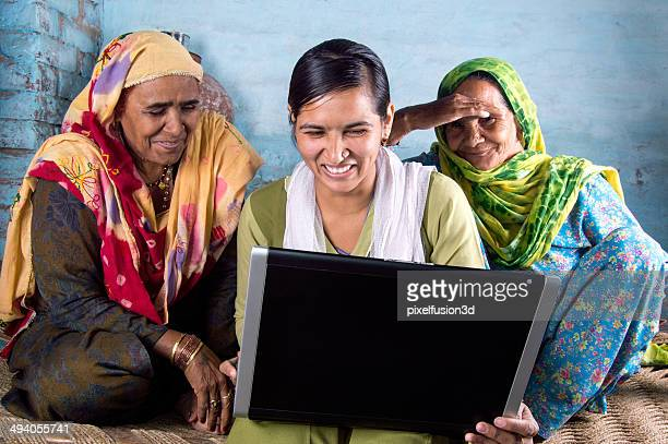 rural girl holding laptop with seniors - village stock pictures, royalty-free photos & images