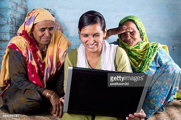 Rural Girl Holding Laptop with Seniors