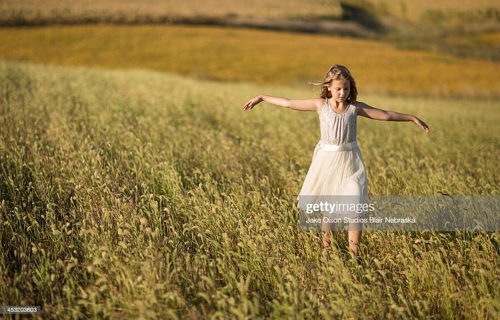 Rural girl in grass : Stock Photo