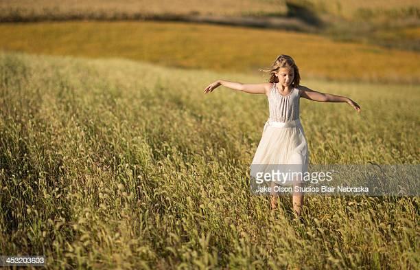 Rural girl in grass