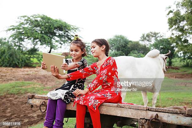 Rural girl using digital tablet