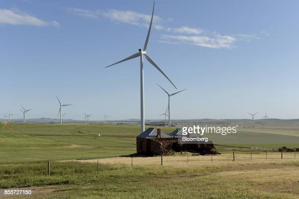 Rural houses stand in front of wind turbines at the Hornsdale wind farm operated by Neoen SAS near Jamestown South Australia on Friday Sept 29 2017...