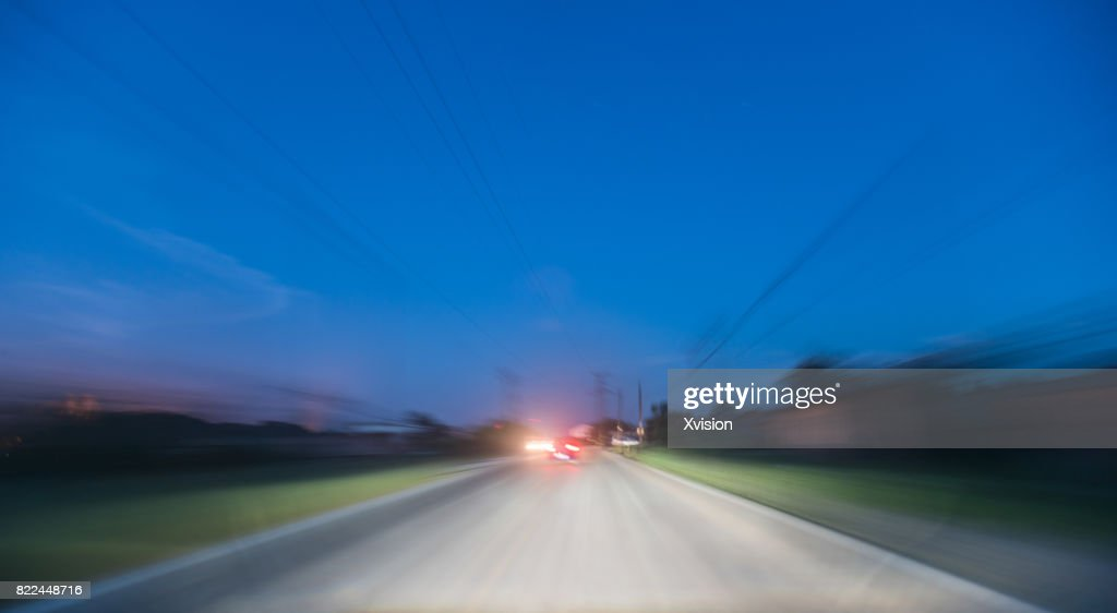 Rural in the dusk under motion blur, real car rigged : Stock Photo