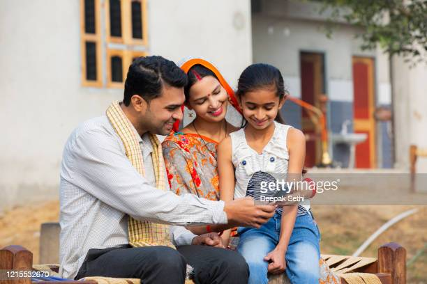 rural indian family at village stock photo - sari stock pictures, royalty-free photos & images