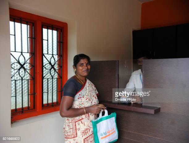 Rural lady in bank by ngo kshtriya gramin financial services by IFMR foundation, Thanjavur, Tamil Nadu, India