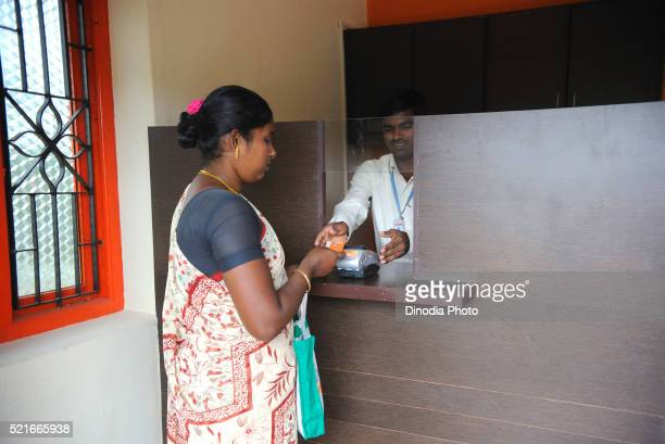 Rural lady showing identity card in bank by ngo kshtriya gramin financial services IFMR foundation Thanjavur
