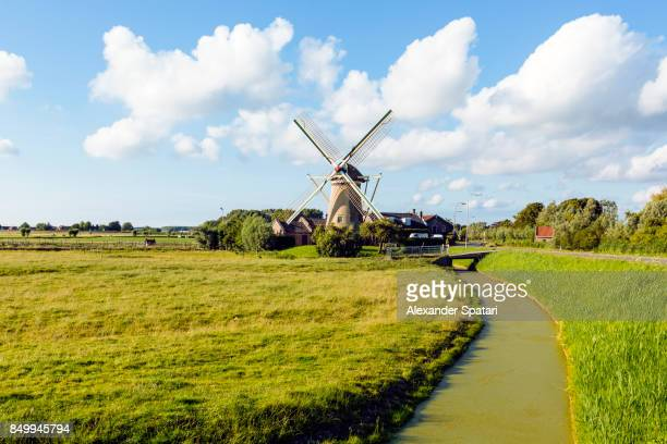 Rural landscape in Holland with traditional windmill, Netherlands