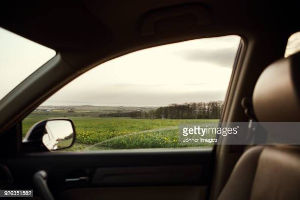 rural landscape seen through car window - vehicle interior stock pictures, royalty-free photos & images