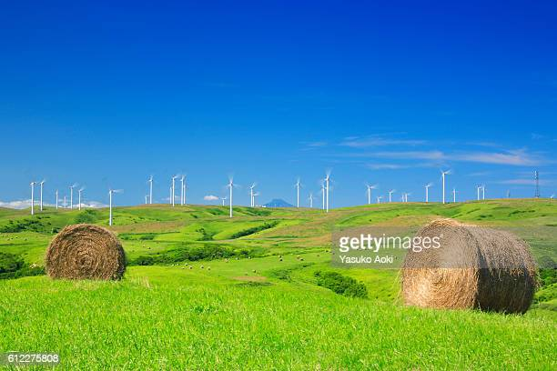 Rural Landscape with Haybales and Wind Turbines