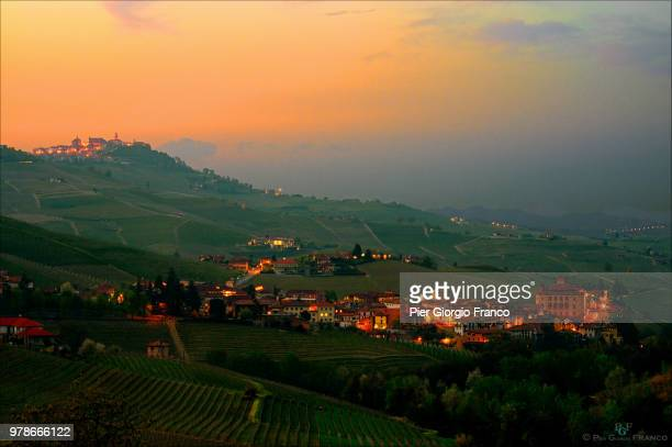 rural landscape with remote city, barolo, la morra, piedmont, italy - piedmont italy stock photos and pictures
