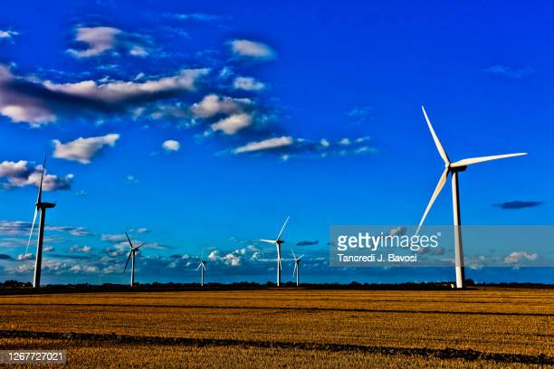 rural landscape with wind turbines - bavosi stock pictures, royalty-free photos & images