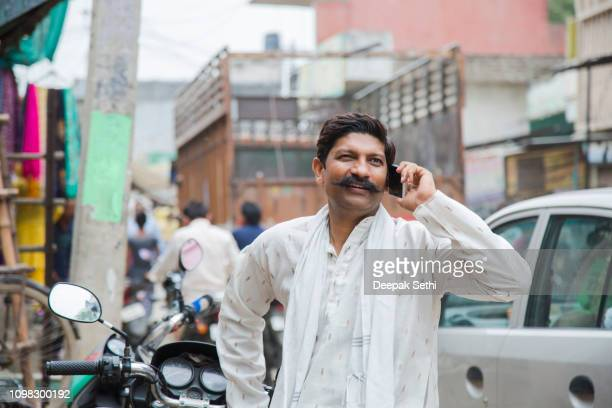 rural man in market - stock images - kurta stock pictures, royalty-free photos & images