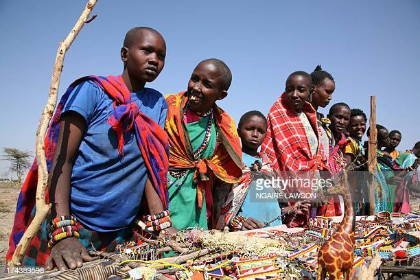 Rural Masai tribal members displaying beaded jewelry and adornments...many such items are traditionally worn and also crafted to sell to visitors to...
