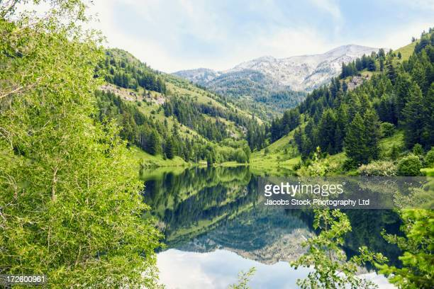 rural mountains reflected in still lake - ketchum idaho stock photos and pictures