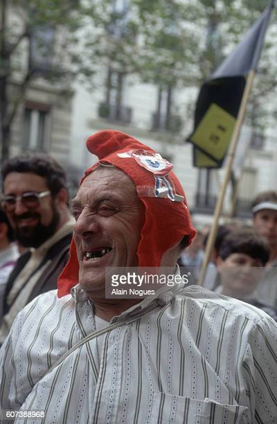 Rural peasant farmers mingle with Parisians during a rally promoting farming