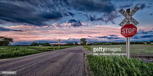 rural railway crossing with dramatic weather - stop sign stock pictures, royalty-free photos & images
