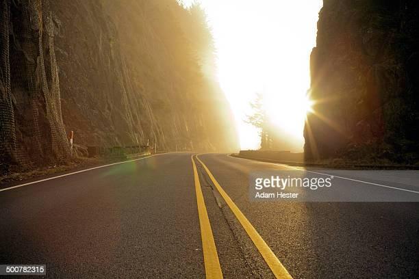 Rural road cutting through mountains