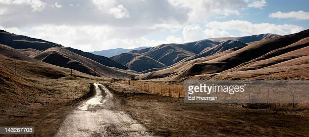 rural road into hilly country - central california stock pictures, royalty-free photos & images