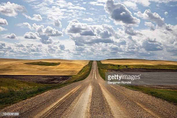 rural road - saskatchewan stock pictures, royalty-free photos & images