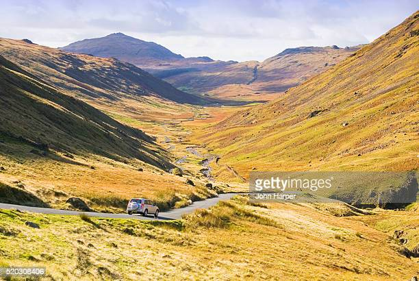 rural road through eskdale valley in lake district - 4x4 stock pictures, royalty-free photos & images