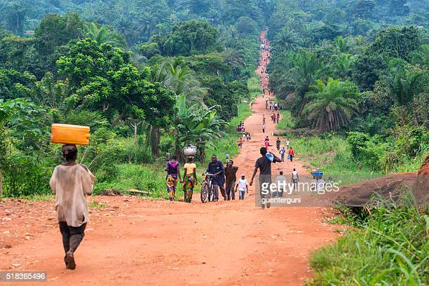 rural road with a lot of pedestrians, dr congo - democratic republic of the congo stock pictures, royalty-free photos & images