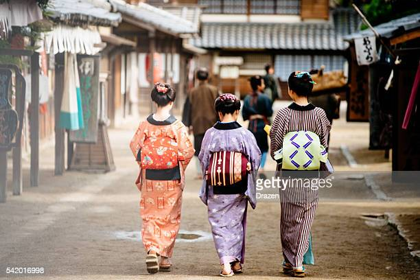 Rural scene in Japanse village with geisha and village people