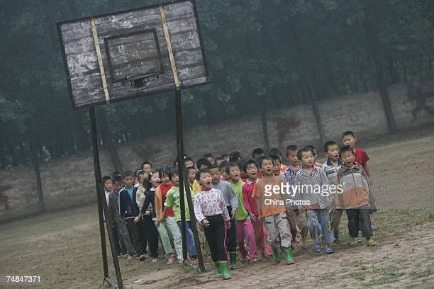 Rural students take part in a physical education class at a Project Hope primary school June 20 2007 on the outskirts of Liaocheng of Shandong...