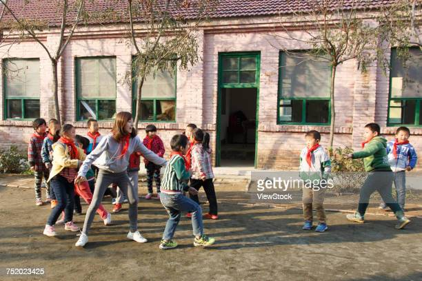 Rural teachers and pupils play games at school