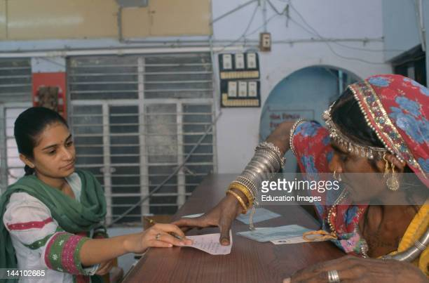 Rural Woman Putting A Thumb Impression In A Bank To Open Her Bank Account At Bank AhmedabadIndia