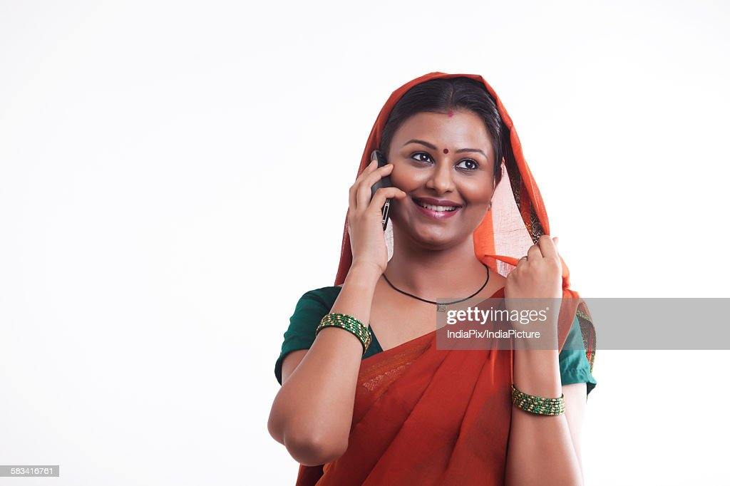Rural woman talking on mobile phone : Stock Photo