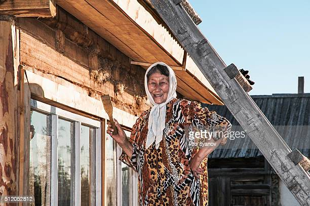 Rural women in their wooden house.