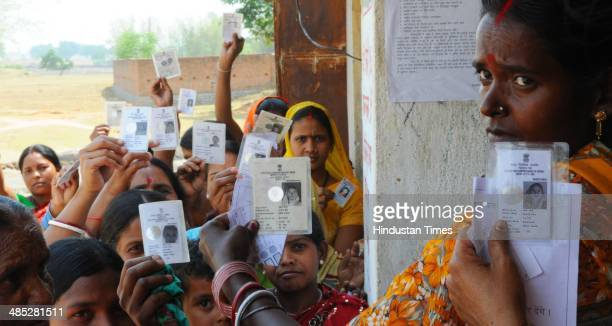 Rural women voters showing their voter indentity cards during the 2nd phase election of Lok Sabha poll for Ranchi constituency at a polling booth at...
