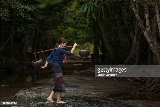 Rural women with nature in the rainy season at the forest.