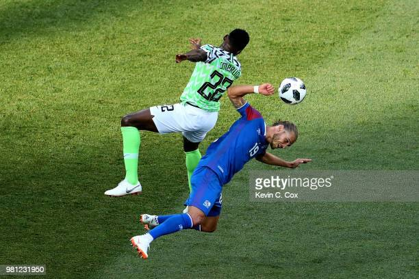 Rurik Gislason of Iceland collides with Kenneth Omeruo of Nigeria as they battle for a header during the 2018 FIFA World Cup Russia group D match...