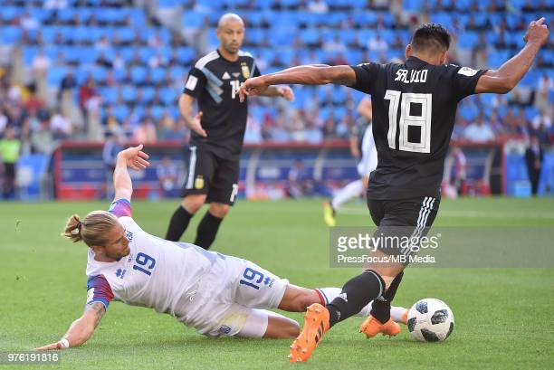 Rurik Gislason of Iceland competes with Eduardo Salvio of Argentina during the 2018 FIFA World Cup Russia group D match between Argentina and Iceland...