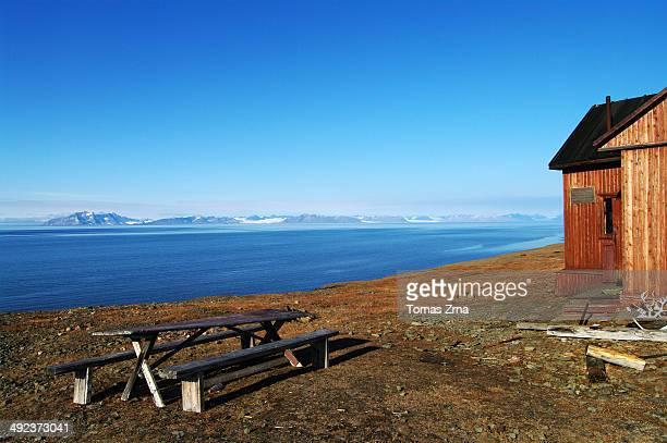 CONTENT] Rusanovodden cabin at former coal mining settlement and port Colesbukta Spitsbergen Svalbard
