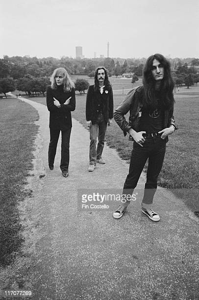 guitarist Alex Lifeson drummer Neil Peart and bassist and singer Geddy Lee Canadian rock band pose for a group portrait on Parliament Hill on...