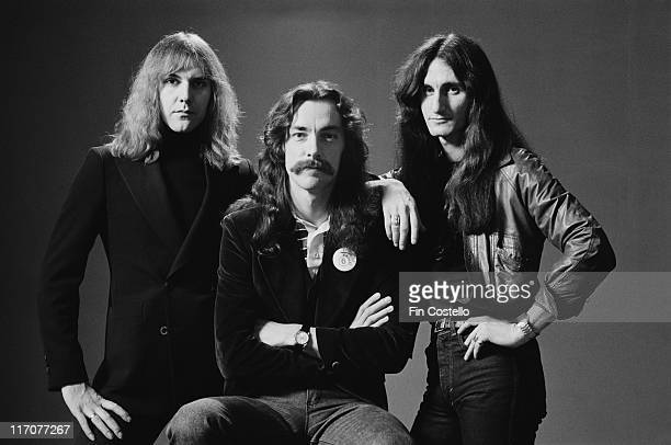 guitarist Alex Lifeson drummer Neil Peart and bassist and singer Geddy Lee Canadian rock band pose for a group studio portrait 1978 The portrait was...