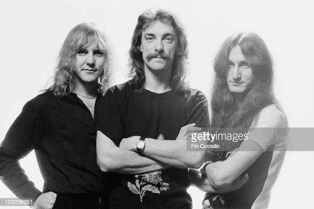 Rush Canadian rock band Rush pose for a group studio portrait against a white background United Kingdom in May 1979