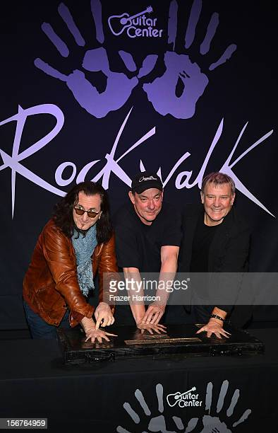 Rush Geddy Lee Neil Peart Alex Lifeson Honored On Guitar Center's RockWalk at Guitar Center on November 20 2012 in Hollywood California