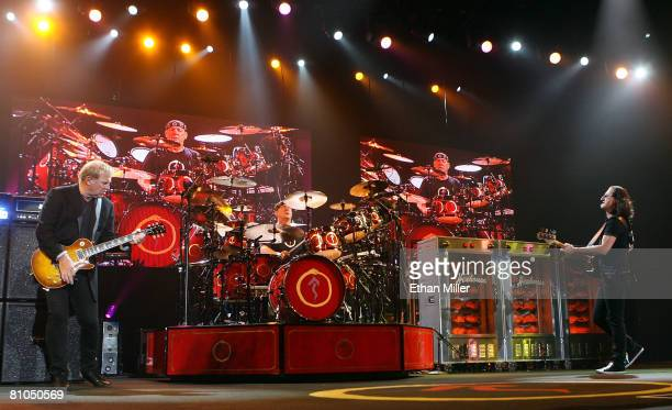 Rush guitarist Alex Lifeson drummer Neil Peart and singer/bassist Geddy Lee perform at the Mandalay Bay Events Center on May 10 2008 in Las Vegas...