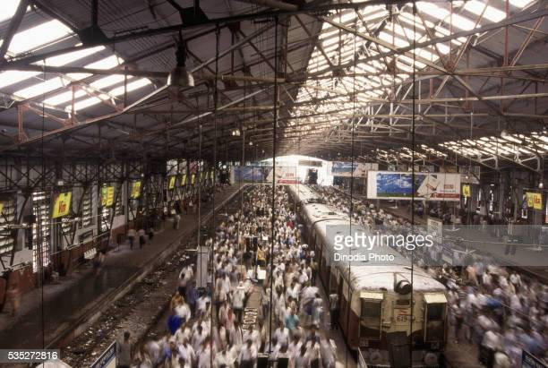 Rush hour at a train station in Bombay, India.