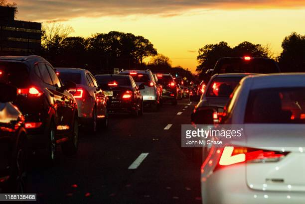 rush hour at sunset - vehicle light stock pictures, royalty-free photos & images