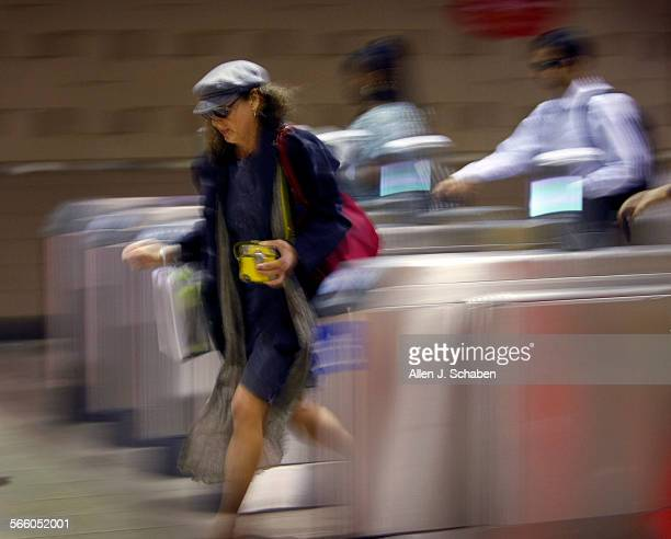 Rush hour commuters make their way through eight new turnstiles that have been installed on the Alameda Street side of Union Station in Los agneles...