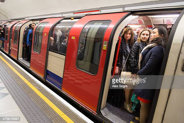 Rush hour commuters on crowded London Underground train England UK