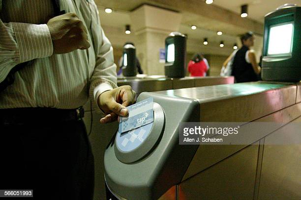 Rush hour commuters swipe their tap card for entry access as they make their way through the eight new turnstiles that have been installed on the...