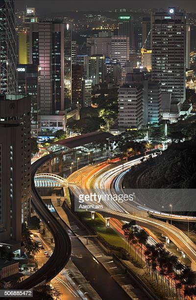 rush hour curvy train track and roads in kuala lumpur - zoom in stock photos and pictures