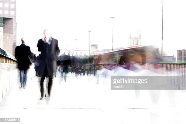 rush hour: high key creative blur of London business commuters