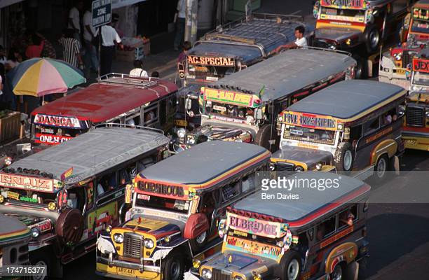 DAGUPAN PANGASINAN PHILIPPINES Rush hour in the city of Dagupan on the island of Luzon where ubiquitous jeepnies gaudily painted and trimmed in...