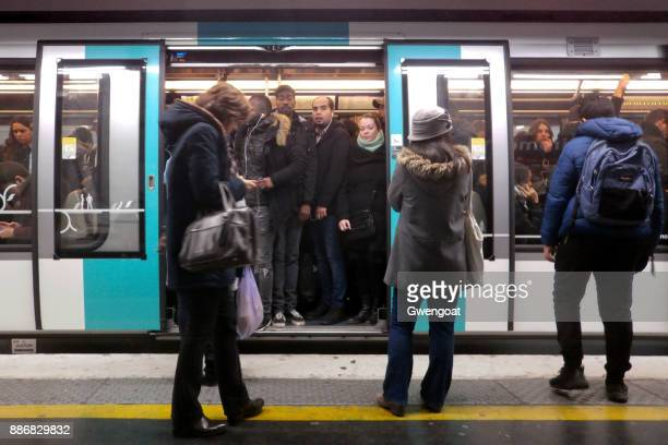 rush hour in the paris metro - crowded subway stock photos and pictures